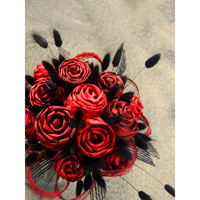 Posy style bouquet with red woven flax rose buds black